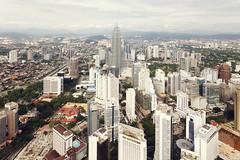 Kuala Lumpur (Christian Wiedel) Tags: city skyline buildings haze asia malaysia kuala canonef1740mmf4lusm metropol lumpur canoneos5d