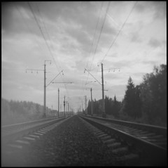 (Arina Borevich) Tags: city railroad summer bw film square outside photography holga lomo lomography russia toycamera railway nobody wires holga120cfn filmphotography moscowregion radovanje