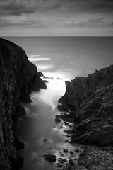 Dove Cave (t3mujin) Tags: longexposure cliff beach portugal landscape bay blackwhite europe waves zoom cove rocky sigma alentejo odemira beja d300s 1020mmf4556exdchsm