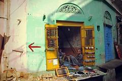 Local jewellery shop (snowpine) Tags: street people india nikon candid streetphotography pushkar rajasthan greenwall yellowdoor  jewelleryshop nikond700 xuesongliao