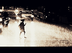 Burning (. Jianwei .) Tags: light wet girl rain station silhouette night vancouver umbrella reflections dark 50mm mood waterfront walk candid sony ghost surreal atmosphere burning 365 carlights  a500 jianwei  kemily