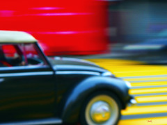 the street (Jack from Paris) Tags: auto street red black texture colors car yellow mobile vw jaune painting rouge lumix automobile raw noir couleurs grain automotive peinture panning mode f71 coccinelle dmclx5 p1000652lx5