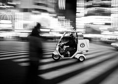 Shinjuku speed (c_c_clason) Tags: street leica blackandwhite japan speed tokyo shinjuku digilux2 scooter motionblur schwarzweiss