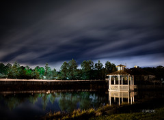 The Gazebo, Again (Dennis Laman) Tags: storm water clouds reflections sony wideangle alpha orangebeach a55