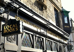 St Andrews Building (Tony Worrall) Tags: uk building sign shop wall architecture scotland photo newspaper blog hand image north scottish tony coastal signage hanging british standrews sunlit citizen hang printers localbooks ©2012tonyworrall teachingliteracy