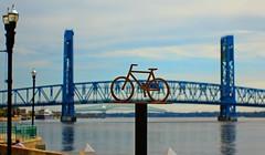 Forced perspective (MnMCarta) Tags: city bridge blue white bike river downtown florida stjohns pole jacksonville forcedperspective