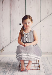 Molly (Lindy Christopher) Tags: wood white studio pretty sitting child dress stripes blueeyes 3yearsold younggirl barndoor wirebasket sideponytail seriousexpression lindychristopher lemondropbackdrop