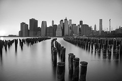 Lower Manhattan Skyline (Michelle in NY) Tags: new york nyc longexposure ny newyork skyline river landscape pier manhattan lower smoothwater neutraldensityfilter lowermanhattanskyline michellegreene wwwmichelleneacycom michelleneacygreene