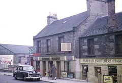 Perth Road (Dundee City Archives) Tags: perthroad dundee victorian old photos architecture buildings housing flats tenements shops cars seafield fruiterers walls ice cream pola cola florist