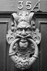 I wouldn't knock on this door (Keith_Prefect) Tags: door face metal devil knocker