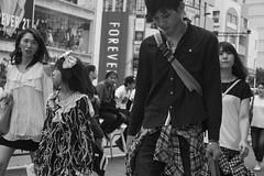 charmed (edwardpalmquist) Tags: street city travel urban blackandwhite woman man girl monochrome fashion japan shopping tokyo crowd shibuya harajuku