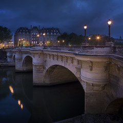 Pont Neuf, Paris (Michel Couprie) Tags: old bridge house paris france reflection water seine architecture night clouds composition canon river eos ancient arch streetlamp squareformat pont bluehour michel nuit pontneuf couprie tse24mmf35l