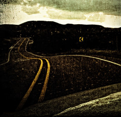 Long and winding road home (flowerweaver) Tags: road texture clouds truck landscape highway driving gritty hills tired arrow whitestripes yellowstripes dirtywindshield earlyevening headinghome curving theroadhome