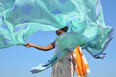 Sari Drying.   Hampi (Claire Pismont) Tags: travel blue portrait woman india motion color colour art colorful asia asie dailylife karnataka sari couleur hampi mouvement drying inde ghat mustsee travelphotgraphy travelshot saridrying lifeinindia earthasia pismont clairepismont