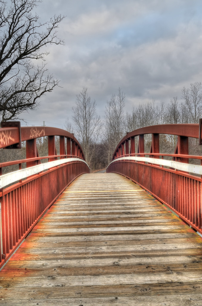 Red arch bridge over the Huron River