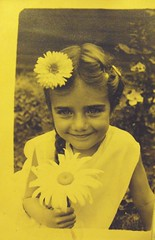 Flower. (:nostalgia:) Tags: old flowers white black cute girl smile hair polaroid found photo big eyes little nostalgia forgotten unknown 1960s braid
