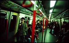 transiting (a.m.medina) Tags: leica boy hk train subway asian fuji bokeh voigtlander hong kong transit medina adrian ttl m6 mtr rvp 100f museopath