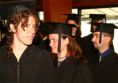 Graduates Sarah Cohen, Ariane Burke and Michael Booxbaum Enter Persons Auditorium for Commencement.