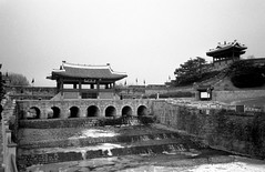 Hwahongmun (EmreKanik) Tags: bridge bw white black film ice analog river lomography mju olympus korea 400 southkorea fortress mjuii hwaseong suwon ladygrey olympusii hwahongmun suwoncheon     lpantiquity