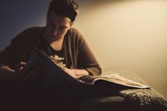 Focus (Robzter83) Tags: light woman lamp girl night reading evening newspaper nikon focus sofa bandana focused cardigan headband april17 2470mm d700