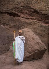 Lonely ethiopian woman monk in a rock church during kidane mehret orthodox celebration, Amhara region, Lalibela, Ethiopia (Eric Lafforgue) Tags: africa old portrait people woman color history church rock vertical architecture outdoors clothing ancient women worship day alone adult african religion headscarf culture monk christian unescoworldheritagesite devotion priest christianity shawl spirituality ethiopia pilgrimage worshipper religiouscelebration oneperson lalibela hornofafrica ethiopian eastafrica orthodoxchurch placeofworship saintmary abyssinia traditionalclothing famousplace cavechurch fulllenght onemanonly traveldestination 1people monolithicchurch builtstructure amhararegion onematurewomanonly ethio163526