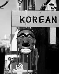 Korean (Mondmann) Tags: shop store asia mask pb korea souvenir korean seoul southkorea souvenirshop rok itaewon eastasia republicofkorea woodenmask mondmann traditionalmask canonpowershotg7x trustedstore souvenirmask