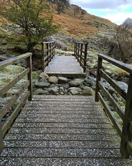 Snowfall On The Footbridges (Marc Sayce) Tags: park lake snow hail track footbridge path district national valley sleet borrowdale rosthwaite