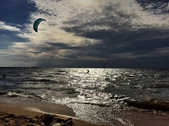 Kiteboarding Alone (Deadly_Dreamer) Tags: blue light kite beach water clouds dark flying sand nikon aqua alone earth magenta kiteboarding explore dirt bearch iphone takenwithiphone 50mm14glens