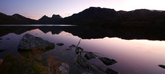 reflections of magenta (keith midson) Tags: sunset sky mountain lake reflection water still rocks dusk calm tasmania tranquil dovelake cradlemountain