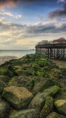 Tides Out (opshorton) Tags: sea water canon pier sand rocks stones tripod carousel 7d manfrotto windturbines canon7d