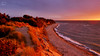 Shoreline of Rügen Island (Germany) (PhotonenBlende) Tags: sunset sea sky orange d50 germany island coast sand nikon meer sonnenuntergang outdoor dusk dune shoreline bank balticsea insel lensflare gras dämmerung ufer rügen ostsee düne küste küstenlinie tamronsp
