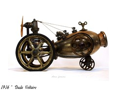 Dada Voltaire (Tinkerbots) Tags: auto sculpture abstract make metal vintage switzerland antique assemblage zurich visualarts machine dada comiccon raygun worldwar1 steampunk sdcc dadaism 1916 danjones foundobjectart dadaists hugoball dieselpunk tinkerbots dadavoltaire