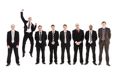 Jumping man in a row with other men (fcm money india) Tags: friends men smile team jumping friendship symbol sweden masculine expression group tie business suit whitebackground success eight isolated necktie symbolism welldressed cheerfull businessteam businessperson confidentteam