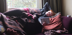 boy in the striped pyjamas, 1 (lesbru) Tags: portrait reading book interior naturallight sofa rug barney x100 23mm