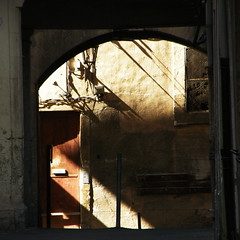 Through The Archway.... (Annie in Beziers) Tags: shadow sunlight france streetscene diagonal shade archway lightanddark bziers centrehistorique fayet annieinbziers rueducapus tourventouse
