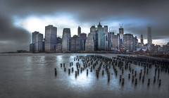 Gloom (Tim Drivas) Tags: nyc newyorkcity newyork skyline brooklyn reflections downtown cityscape skyscrapers cloudy manhattan piers worldtradecenter financialdistrict eastriver gothamist hdr piles brooklynbridgepark freedomtower 1wtc 8spruce