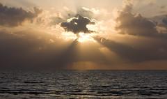The runner (J1I9M7M4Y) Tags: ocean sea sky cloud sun beach clouds canon eos skne sweden sverige sunrays runner ngelholm sunbursts jimyy
