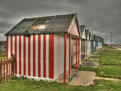 Beach huts of Sutton on Sea (DaveKav) Tags: cloud olympus lincolnshire huts seafront beachhuts hdr sutton e510 suttononsea
