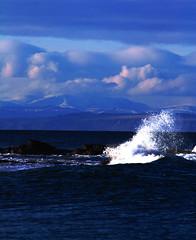 Coast (Gazasal) Tags: sea sky snow black mountains beach clouds coast rocks waves ben cliffs splash isle moray firth hopeman wyvis gazasal