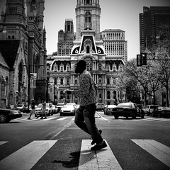 Taking A Jog On The Crosswalk Catwalk (Joel Levin Photography) Tags: street blackandwhite bw usa philadelphia square cityhall candid streetphotography squareformat philly crosswalk catwalk allrightsreserved mobilephotography flickraward bwartaward thedefiningtouch iphoneography deftouch editedanduploadedoniphone flickrawardgallery crosswalkcatwalk joellevin definingtouchgroup