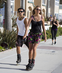 Rollerblading couple (San Diego Shooter) Tags: portrait beach sandiego streetphotography rollerblading pacificbeach sandiegopeople sandiegostreetphotography