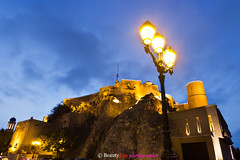 Muscat - Al Mirani Fort . . . [Explored] (Beauty Eye) Tags: city longexposure nightphotography sunset mountain seascape building eye architecture night photoshop canon dark landscape eos rebel lights landscapes long exposure day nightshot fort outdoor scene adobe bluehour om tamron oman muscat 2012 lightroom  t3i mct mirani  cameraraw ultrawideangle   f3545 600d     beautyeye masqat 1024mm  canon600d   tamronspaf1024mmf3545diiild rebelt3i kissx5 diiild canon600deos oman omanomancountry tamronspaf1024mmf3545d