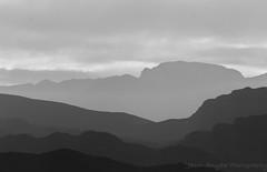 Vegas Badlands (Meteorseeker) Tags: light sunset summer sky sun mountains nature monochrome skyline canon landscape outside shadows desert lasvegas outdoor nevada shadowplay mountainpeak canon60d canonfanphotography