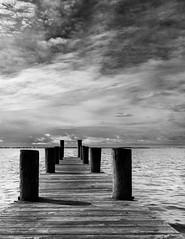 After the Storm (petojustin) Tags: ocean sea blackandwhite bw seascape beach water monochrome clouds landscape outdoors blackwhite dock fuji waterfront florida shoreline stuart x70 fujix70