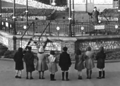Might be worth watching (theirhistory) Tags: winter girls england man boys hat kids children shoes audience boots path coat raincoat wellies tailings