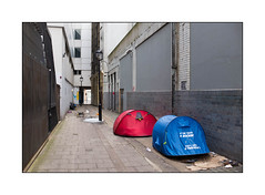 Homeless in West London, England. (Joseph O'Malley64) Tags: uk greatbritain windows england london wall tents alley britain pavement homeless cctv security lamppost cardboard alleyway british walls drainpipe railings vagrant brickwork westlondon destitute homelessness bereft camped dispossessed glazedbricks