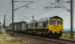 Freightliner Class 66/5 no 66553 & unknown sister at Gamston Foot Crossing on 23-06-2016 with a Felixstowe to Doncaster Intermodal. (kevaruka) Tags: uk railroad morning blue summer england color colour green colors june yellow train canon eos star coast flickr colours britain outdoor united main great transport rail railway kingdom trains front 66 class line east page vehicle 5d british locomotive network nottinghamshire retford mk3 2016 freightliner ecml ef100400 railfreight gamston f4556l 66553 gbrf 66702 5d3 66779 5diii thephotographyblog ilobsterit