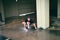 serfin (AndrewStraub) Tags: wet water rain puddle skateboarding skating drew skate skateboard skater rogers serfin