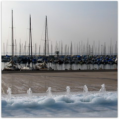 ouchy on the rocks (overthemoon) Tags: lake ice fountain port boats schweiz switzerland frozen shadows suisse harbour freezing lakeside lausanne promenade fountains icy svizzera lman masts ouchy spouts glace lakegeneva moorings glacial vaud digue romandie bsquare