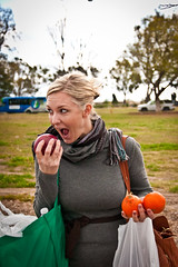 Rebecca taking a bite (FrogMiller) Tags: fruit funny rebecca farmers market bags organic grocery oc newell irvine ocgreatpark
